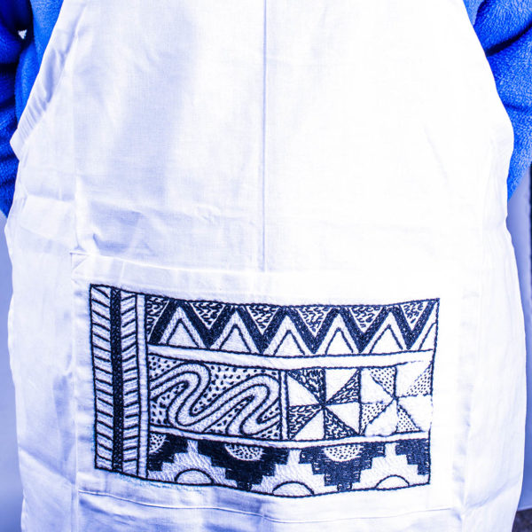 Apron with embroidered pocket