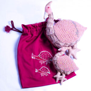 Guinea fowl and baby in a bag